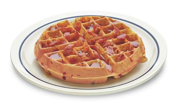 "Bac 'n' Cheddar Waffle at IHOP: an iconic IHOP Belgian waffle with hickory-smoked bacon crumbles and Cheddar cheese goop baked inside, then topped with more bacon. Total calories: 820. Fat grams: 48. Sodium: 1,640 mg. Carbs: 62 g. Dietary fiber: 3 g. Protein: 3 g. Manufacturer's suggested retail price: $6.99.What Hoffman says:Waffles, bacon, cheese and butter… this is almost cheating. No wonder Pizza Hut is obsessed with hiding bacon and cheese in its crust. It's like finding buried treasure. And you don't have to take your gold and silver doubloons to a TV pawn shop where the Old Man nickels and dimes you. Less Old Man, more Chumlee, got it, A&E? That's not the only ""waffullicious"" menu item. Click here to find out what other new waffle is leaving Hoffman blue in the face. Photo: IHOP"