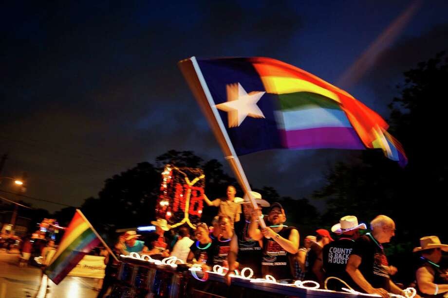 Left: Participants celebrate in last year's Houston Gay Pride Parade.  Photo: Eric Kayne / Eric Kayne