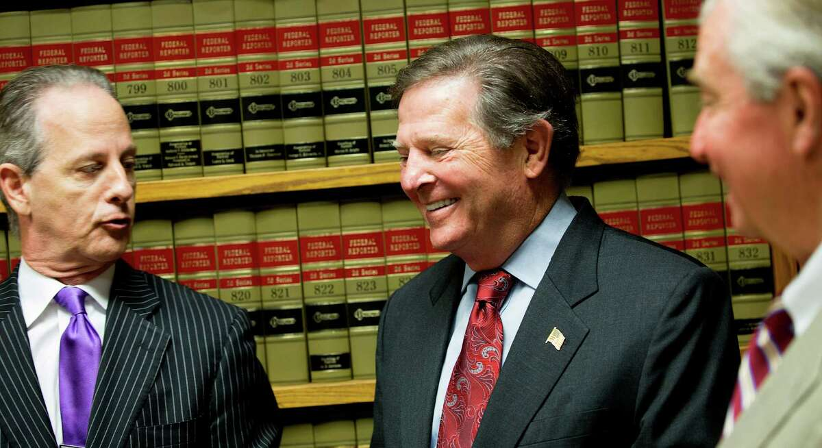 Next to his attorneys, Brian Wice, left, and Dick DeGuerin, Tom DeLay former House Majority Leader Tom DeLay, R-Texas was all smiles after the Texas Court of Criminal Appeals refused to reinstate two money-laundering convictions Wednesday, Oct. 1, 2014, in Houston. Wice said he received a phone call at 9 a.m. with the news. DeLay was convicted in 2010 for money laundering and conspiracy to commit money laundering. DeLay credits God with sustaining him through this process.
