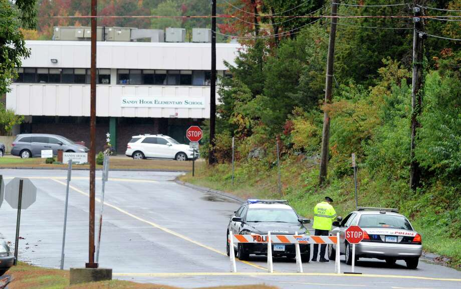 Police are stationed outside the Sandy Hook Elementary School in Monroe, the former Chalk Hill Middle School, after someone called in a bomb threat Wednesday, Oct. 1, 2014. Students were evacuated and the school and grounds were checked and no evidence of any explosives was found. Photo: Autumn Driscoll / Connecticut Post