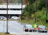 Police are stationed outside the Sandy Hook Elementary School in Monroe, the former Chalk Hill Middle School, after someone called in a bomb threat Wednesday, Oct. 1, 2014. Students were evacuated and the school and grounds were checked and no evidence of any explosives was found.