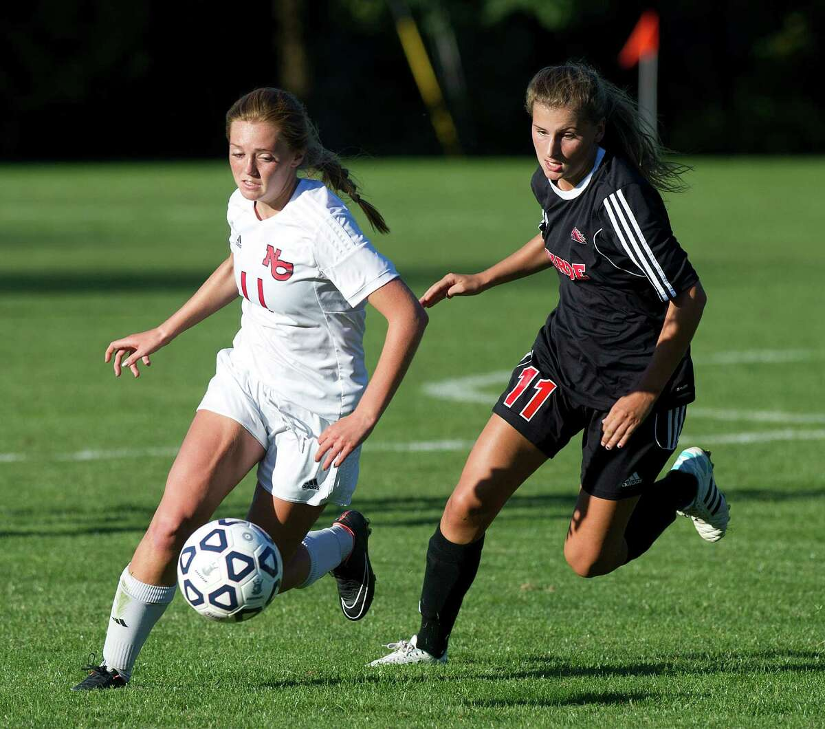 New Canaan's Kelly McClymonds, left, and Fairfield Warde's Hannah Allen, right, compete for control of the ball during a girls soccer game in New Canaan on Friday, Sept. 26.