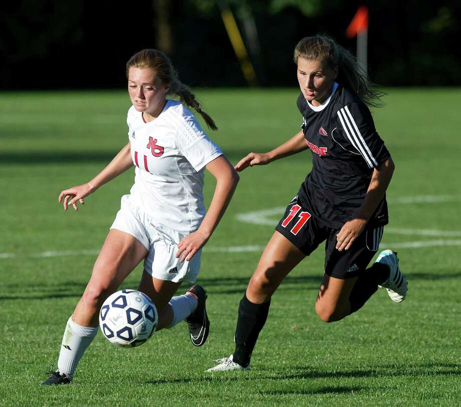 New Canaan's Kelly McClymonds, left, and Fairfield Warde's Hannah Allen, right, compete for control of the ball during a girls soccer game in New Canaan on Friday, Sept. 26. Photo: Lindsay Perry / Stamford Advocate