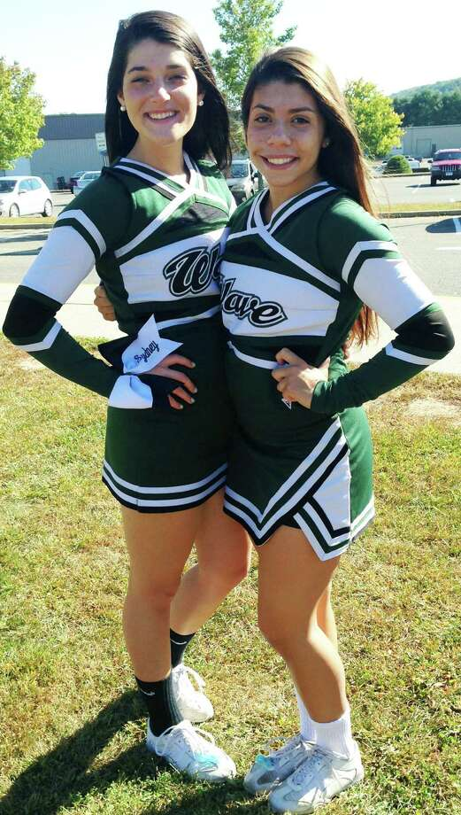 Sydney Fairchild, left, and Alyssa Santos of the New Milford High School cheerleading squad are fundraising for a planned trip to London, England. October 2014  Courtesy of Colleen Fairchild Photo: Contributed Photo / The News-Times Contributed