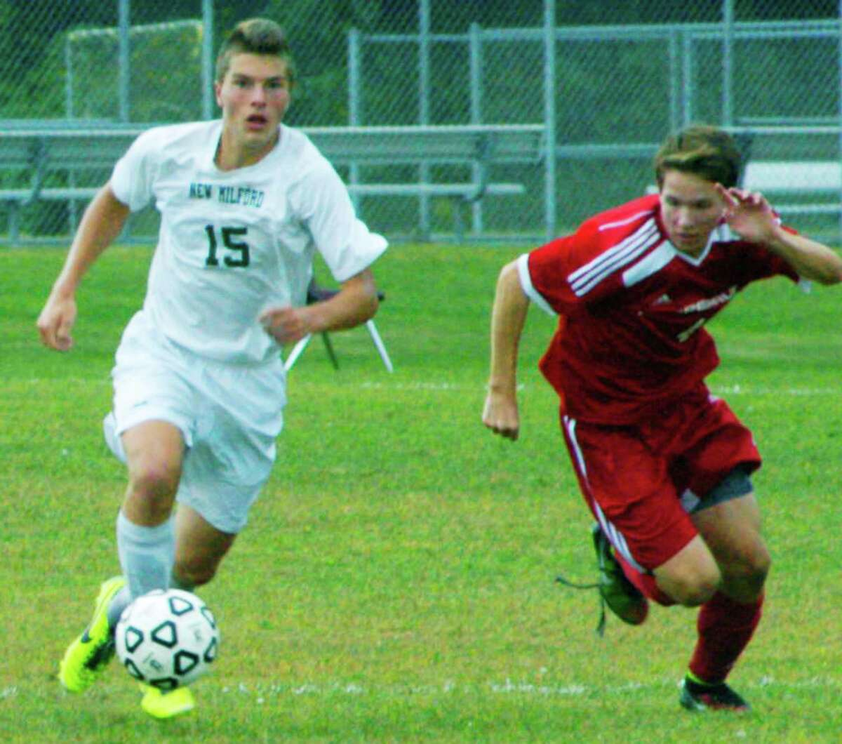 Spencer Ranno of the Green Wave kicks it into a higher gear during New Milford High School boys' soccer's 2-1 victory over Pomperaug, Sept. 20, 2014 at NMHS.