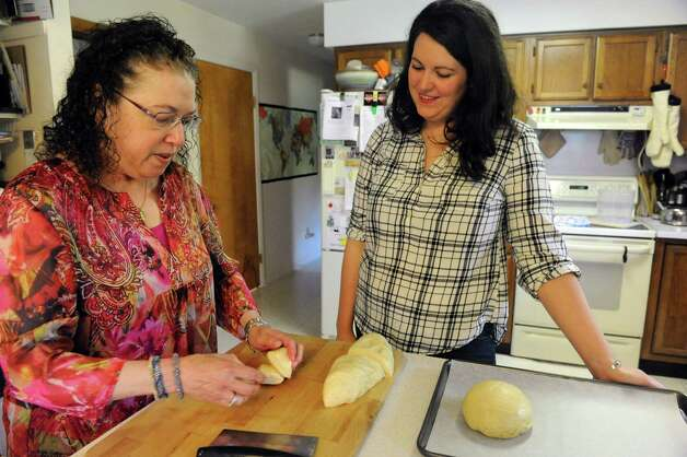 Cecile Kowalski, left, shows Deanna Fox, right, how to make challah bread  Friday Sept. 26, 2014, at Kowalski's home in Selkirk, N.Y.  (Michael P. Farrell/Times Union) Photo: Michael P. Farrell / 00028757A