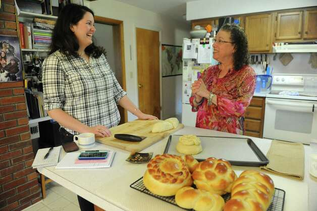 Deanna Fox, left, learns how to make challah bread with Cecile Kowalski on Friday, Sept. 26, 2014, in Selkirk, N.Y.  (Michael P. Farrell/Times Union) Photo: Michael P. Farrell / 00028757A
