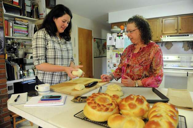Deanna Fox, left, learns how to make challah bread with Cecile Kowalski Friday, Sept. 26, 2014, in Selkirk, N.Y.  (Michael P. Farrell/Times Union) Photo: Michael P. Farrell / 00028757A