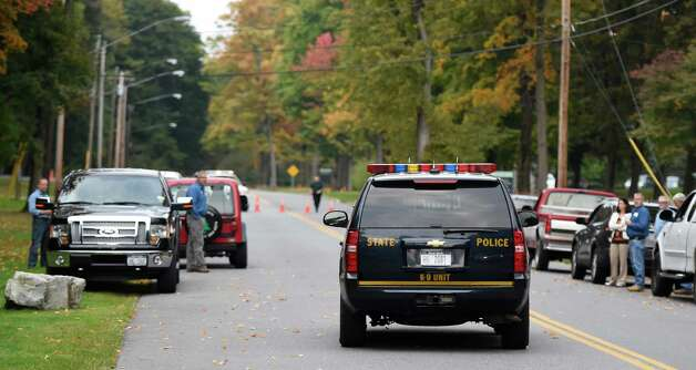 A NYS Police vehicle goes through the road block at Skidmore College this morning Oct. 1, 2014 during the search for a sexual-assault parole violator in Saratoga Springs, N.Y.  Saratoga Police apprehended the perpetrator at approximately 7 am this morning.      (Skip Dickstein/Times Union) Photo: SKIP DICKSTEIN / 00028853A