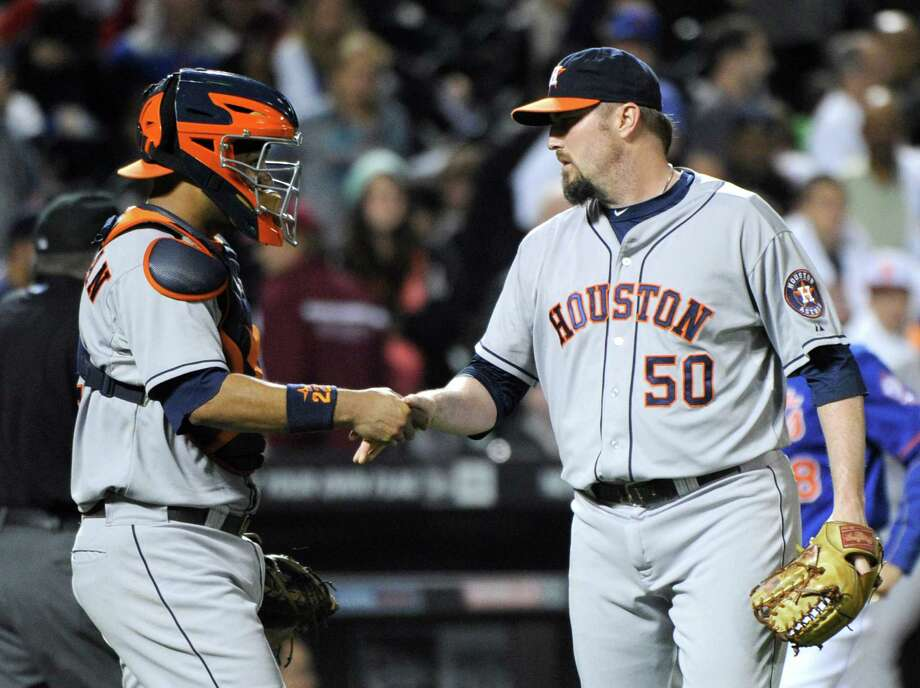 Houston Astros pitcher Chad Qualis, right, celebrates with catcher Carlos Corporan after the Astros defeated the New York Mets, 3-1, in an inter-league baseball game Friday, Sept. 26, 2014, at Citi Field in New York. (AP Photo/Bill Kostroun) Photo: Bill Kostroun, FRE / FR51951 AP