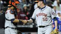 Houston Astros pitcher Chad Qualis, right, celebrates with catcher Carlos Corporan after the Astros defeated the New York Mets, 3-1, in an inter-league baseball game Friday, Sept. 26, 2014, at Citi Field in New York. (AP Photo/Bill Kostroun)