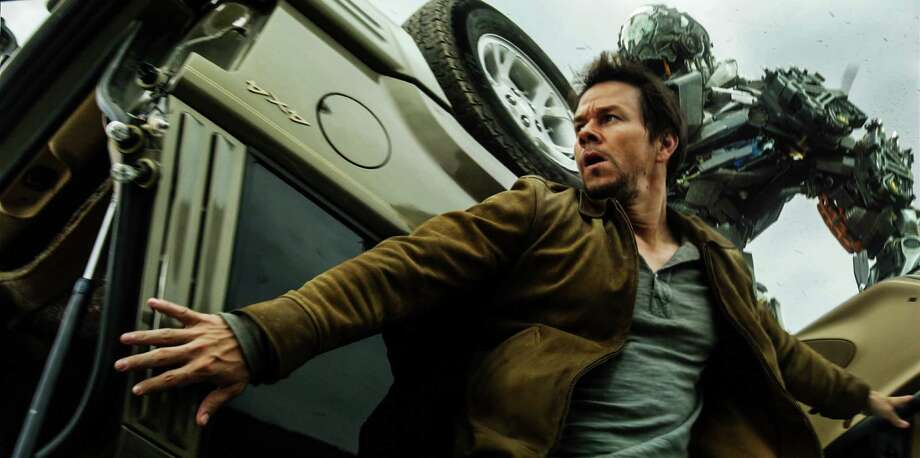 """This photo released by Paramount Pictures shows, Mark Wahlberg, front, as Cade Yeager, and Lockdown, rear, in a scene from the the film, """"Transformers: Age of Extinction."""" (AP Photo/Paramount Pictures, ILM) ORG XMIT: CAET158 Photo: Industrial Light & Magic / Paramount Pictures"""