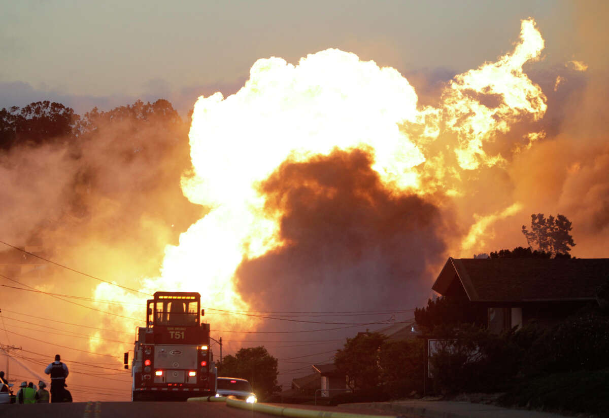 Fire roars through San Bruno's Crestmoore neighborhood after the explosion of a Pacific Gas and Electric Co. gas pipeline Sept. 9, 2010. (AP Photo/Paul Sakuma, File)