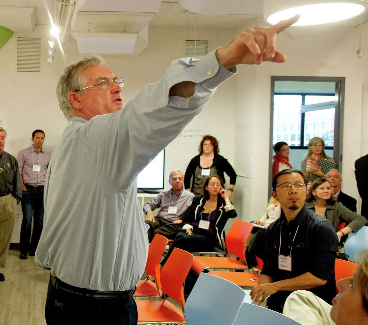 Bryan Mattimore of The Growth Engine leads a brainstorming session during the Creativity in the Workplace program at Comradity's Stamford office on Wednesday, October 1, 2014.