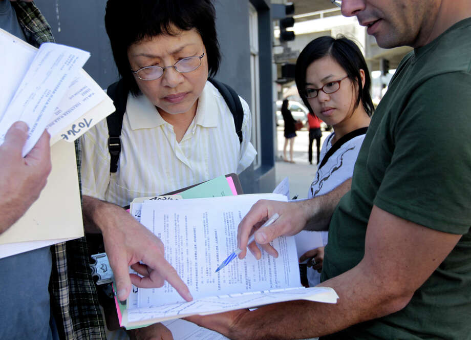 Yes on J campaign volunteers Mariana Wong (left) and Annelisa Luong get instructions before canvassing the Silver Terrace neighborhood in S.F. last week. Proposition J would raise the minimum wage to $15 an hour. Photo: Paul Chinn / The Chronicle / ONLINE_YES