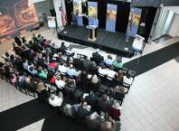 Emma Price, at podium, a senior at Saratoga Springs High School, speaks at a program Wednesday at SUNY Polytechinic Institute in Albany. (Photo supplied by SUNY Polytechnic Institute)