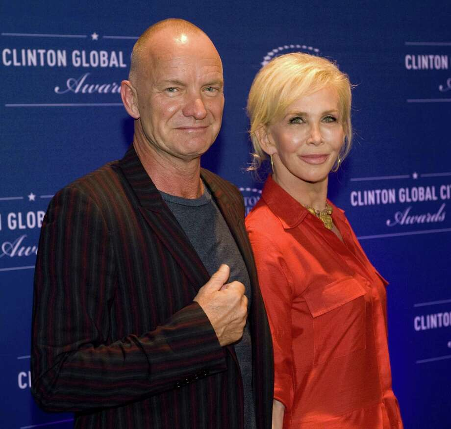 Musician Sting and wife Trudy Styler attend  the 8th Annual Clinton Global Citizen Awards ceremony in New York September 21, 2014.  AFP PHOTO/STEPHEN CHERNINSTEPHEN CHERNIN/AFP/Getty Images ORG XMIT: US-POLITI Photo: STEPHEN CHERNIN / AFP