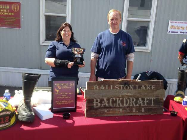 The Ballston Lake Fire Department and their ?Ballston Lake Backdraft Chili? won the Firefighter Chili Cook-Off, hosted by Mazzone Hospitality Prime Business Dining and Globalfoundries, at Foundry Cafe in Malta on Sept. 23.The sampling raised $1,000, and with a matching donation from Mazzone Hospitality, a total of $2,000 will be donated to the National Fallen Firefighters Foundation. From left are Patti and Pat Southworth from Ballston Lake Fire Department. (Submitted photo)