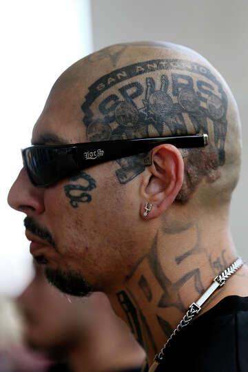 John Jimenez Sports The Championship Trophies Tattoo While