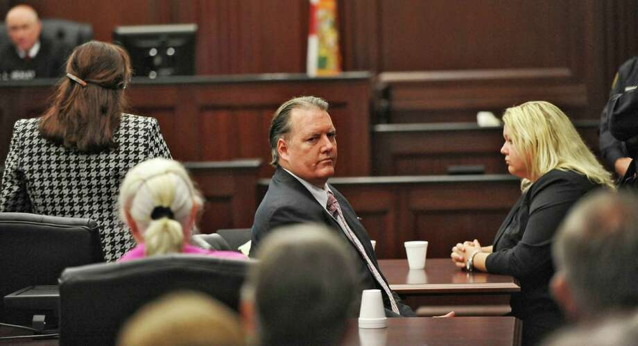 Michael Dunn, center, looks back at his parents after the verdict of guilty in his retrial Wednesday in  the Duval County Courthouse in Jacksonville, Fla. Photo: Bob.Mack, POOL / Pool The Florida Times-Union