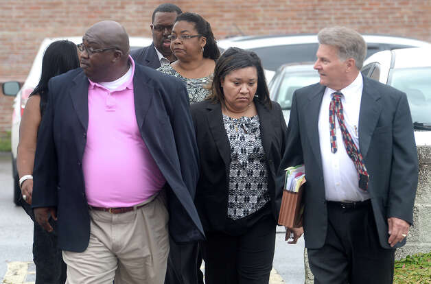 Flanked by family and her attorney, former BISD comptroller Sharika Allison (center) makes her way into the Federal Courthouse Thursday morning for her sentencing. Allison, along with former Chief Financial Officer Devin McCraney were indicted by a federal grand jury in January on 19 counts of conspiracy and fraud. The pair pled guilty in April. Photo taken Thursday, September 18, 2014 Kim Brent/@kimbpix Photo: KIM BRENT / Beaumont Enterprise