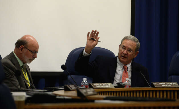 BISD president Dr. Jimmy Simmons puts board members to a vote during an afternoon meeting Monday. Photo taken Monday, September 29, 2014 Kim Brent/@kimbpix Photo: KIM BRENT / Beaumont Enterprise