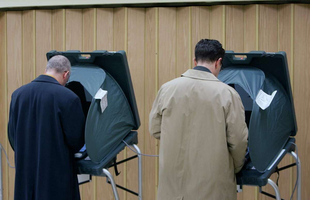 Voters cast their ballots at the Metropolitan Multi-Services Center, Tuesday, March 4, 2014, in Houston. (Cody Duty / Houston Chronicle)