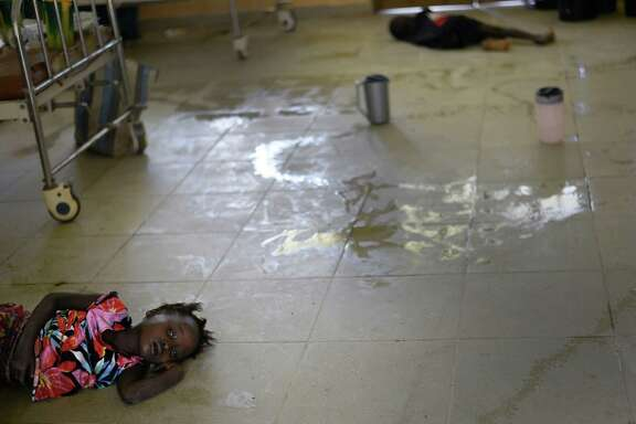 Mariattu Kanu, 4, who is suspected of being infected with Ebola, lies on the floor amid body fluids in a ward for Ebola victims at a hospital in Makeni, Sierra Leone. The country was not ready to handle the onslaught, officials said.