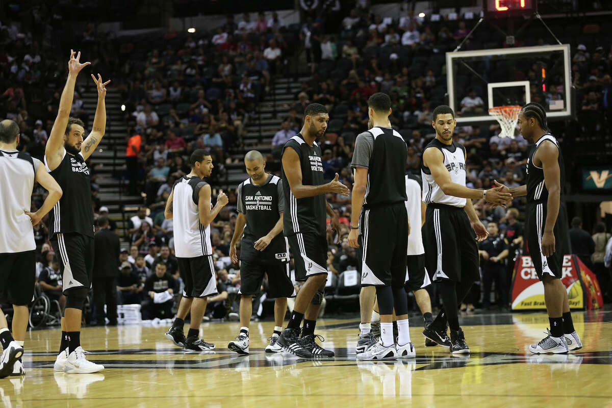 The San Antonio Spurs gather at midcourt for their public practice at the AT&T Center, Wednesday, Oct. 1, 2014.