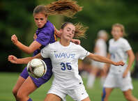 Westhill's Jessica Laszlo and Darien's Charlotte Harmon compete for the ball during their soccer game at Darien High School in Darien, Conn., on Wednesday, Oct. 1, 2014. Westhill won, 3-1.