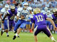 Shaker's quarterback Matt Woods, center, carries the ball during their football game against CBA on Friday, Sept. 5, 2014, at Christian Brothers Academy in Colonie, N.Y. (Cindy Schultz / Times Union)