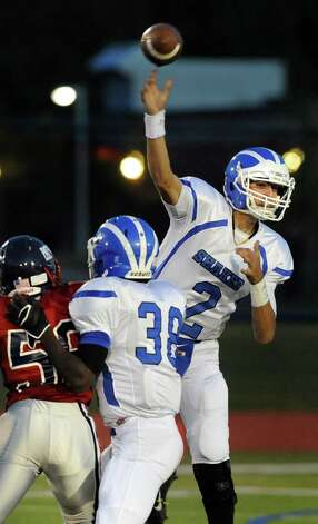 Shaker's quarterback Matt Woods, right, releases a pass during their football game against Schenectady on Friday, Sept. 19, 2014, at Schenectady High in Schenectady, N.Y. (Cindy Schultz / Times Union) Photo: Cindy Schultz / 00028670A