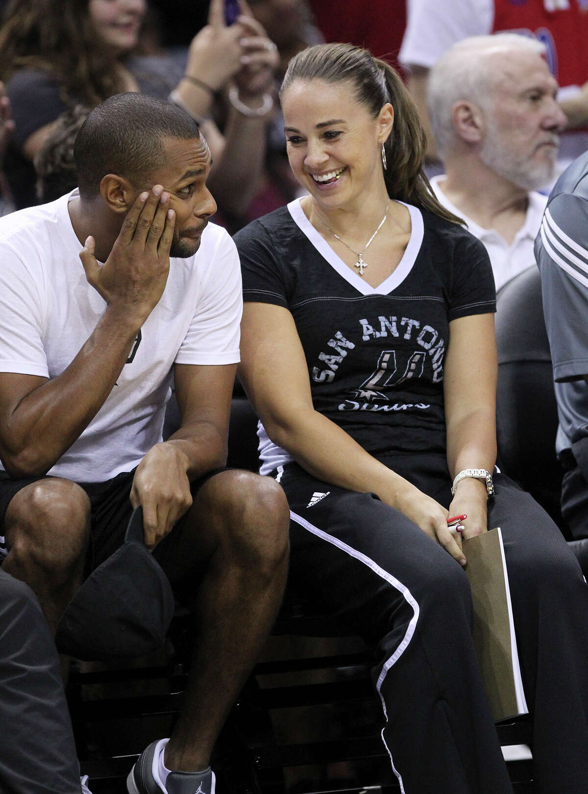 Assistant Coach Becky Hammon jokes with Patty Mills during the San Antonio Spurs public practice at the AT&T Center, Wednesday, Oct. 1, 2014.