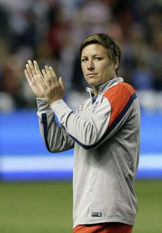 FILE - In this Sept. 13, 2014, file photo United States' forward Abby Wambach (20) walks off the field following an international friendly game with Mexico, in Sandy, Utah. A group of elite players has filed a lawsuit in Canada challenging plans to play the 2015 Women's World Cup on artificial turf. The players, led by U.S. women's national team forward Abby Wambach, filed Wednesday, Oct. 1, 2014,  in the human rights tribunal of Ontario next week, attorney Hampton Dellinger said.  (AP Photo/Rick Bowmer, File) ORG XMIT: NY170 Photo: Rick Bowmer / AP