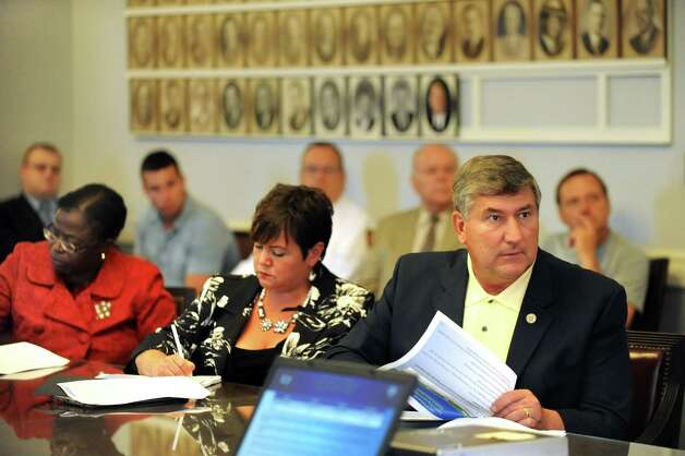 City council members Marion Porterfield, left, Leesa Perazzo, center, and Ed Kosiur listen to Mayor Gary McCarthy's 2015 budget presentation on Wednesday, Oct. 1, 2014, at City Hall in Schenectady, N.Y. (Cindy Schultz / Times Union) Photo: Cindy Schultz / 00028841A