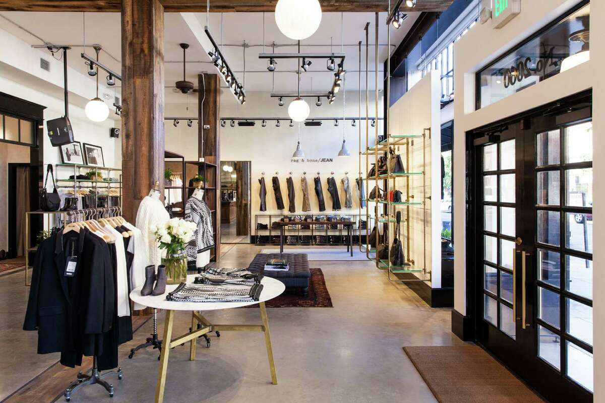 Rag & Bone on Fillmore offers neatly arranged clothing for men and women in a setting of industrial finishes mixed with reclaimed wood columns and antique brass fixtures.