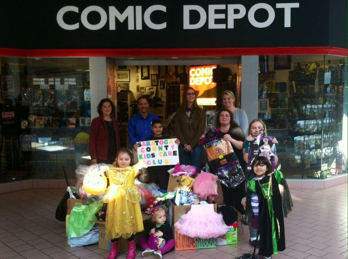 Members of the Saratoga County Kids Care Club pose outside of the Comic Depot in Saratoga Springs with donated costumes they collected throughout Saratoga County. This year, organizers are hoping to collect more than the 145 costumes donated during last year?s Halloween costume drive. (Saratoga County Kids Care Club)