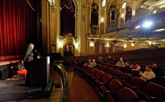 Holly Brown, executive director, officially unveils the new digital projection system during a press conference Feb. 27, 2014, at the Palace Theatre in Albany, N.Y. (Skip Dickstein / Times Union) Photo: SKIP DICKSTEIN / 00025818A