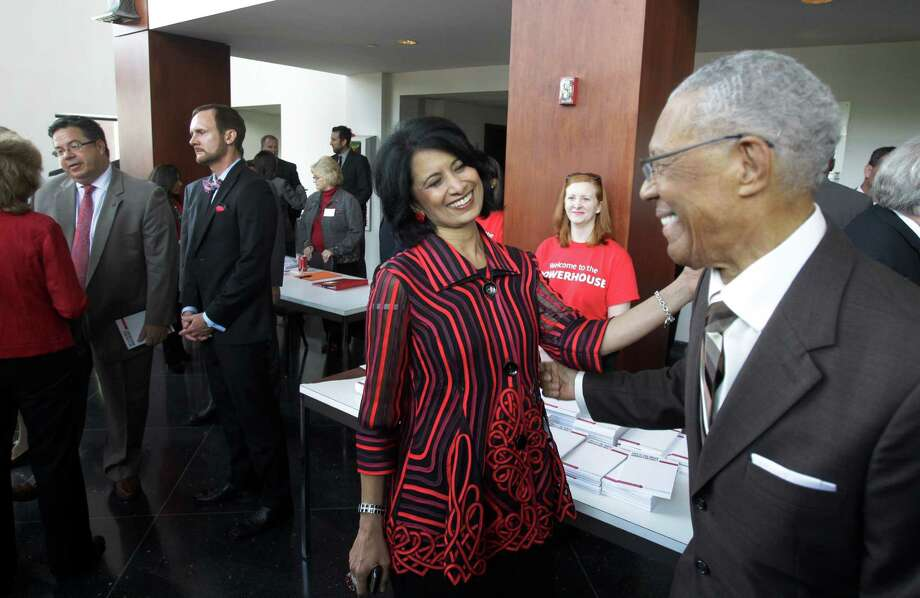 Renu Khator, president of the University of Houston, left, visits with Rev. William Lawson  after the annual State of the University at Moores Opera House Wednesday. Photo: Melissa Phillip, Staff / © 2014  Houston Chronicle