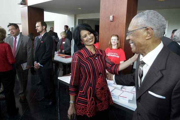 Renu Khator, president of the University of Houston, left, visits with Rev. William Lawson  after the annual State of the University at Moores Opera House Wednesday.