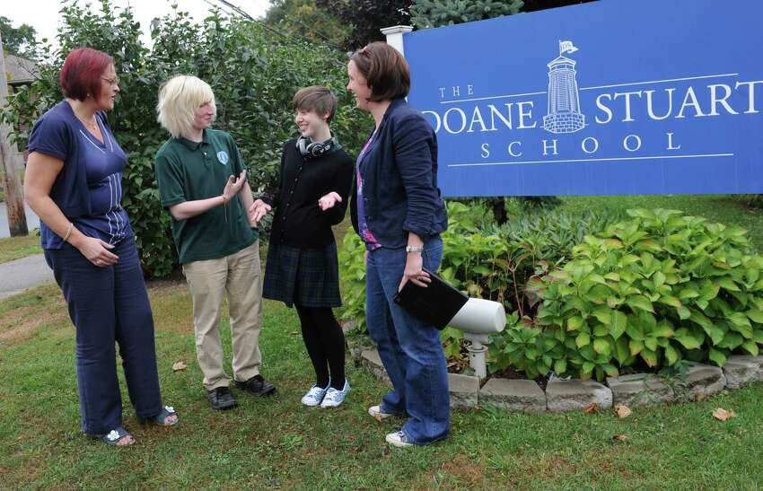 Amanda McNamee, left, principal of Lagan College and vice principal Jayne Atkinson, right, talk with students Dylan Boyd, 18, and Natasha Russell, 18, at Doane Stuart School on Wednesday, Oct. 1, 2014 in Rensselaer, N.Y. McNamee and Atkinson are leaders of the school in Northern Ireland that has made historic inroads in bringing together Catholic and Protestant students and Lagan & Doane Stuart has had a cultural exchange for years. (Lori Van Buren / Times Union)