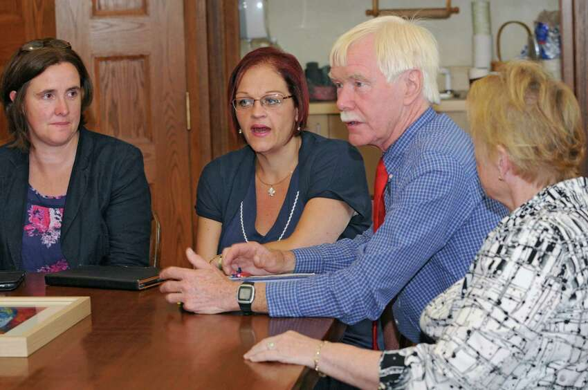 From left, Amanda McNamee, principal of Lagan College and vice principal Jayne Atkinson meet with Doane Stuart School teacher and co-director Seamus Hodgkinson and Pam Clarke, head of school, on Wednesday, Oct. 1, 2014 in Rensselaer, N.Y. McNamee and Atkinson are leaders of the school in Northern Ireland that has made historic inroads in bringing together Catholic and Protestant students and Lagan & Doane Stuart has had a cultural exchange for years. (Lori Van Buren / Times Union)
