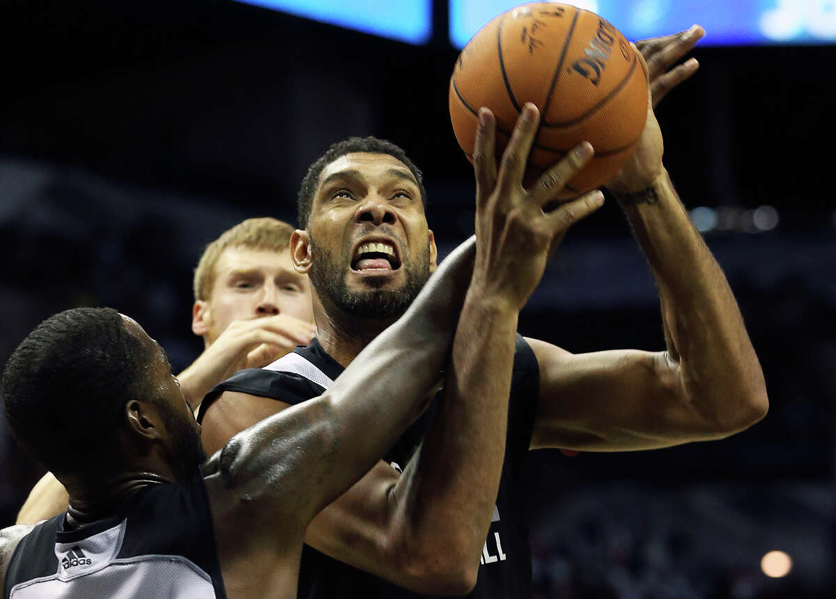 Tim Duncan fights in the blocks as the Spurs conduct an open scrimmage at the AT&T Center on October 1, 2014.