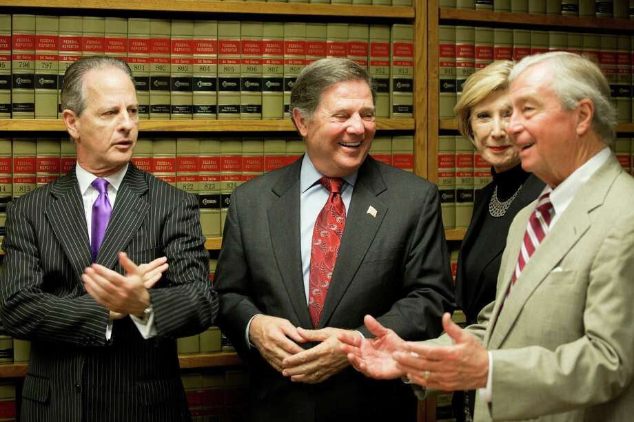 Former House Majority Leader Tom DeLay, second from left, with attorneys Brian Wice, left, Adele Hedges and Dick DeGuerin, is all smiles after the Court of Criminal Appeals refused to reinstate two money-laundering convictions. Photo: Johnny Hanson, Staff / © 2014  Houston Chronicle