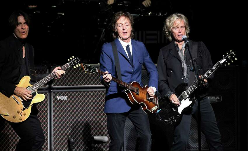 Rock icon Sir Paul McCartney (center) performs at the Tobin Center on Wednesday, Oct. 1, 2014.