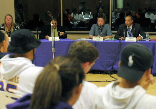 John Carmello, right, Troy School Superintendent speaks about student involvement in a homecoming incident talks before the Troy School board at Troy Middle School on Wednesday Oct.1 , 2014 in Colonie, N.Y.  (Michael P. Farrell/Times Union) Photo: Michael P. Farrell / 00028855A
