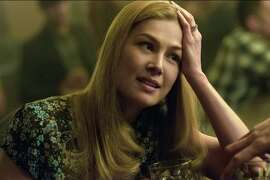 "In this image released by 20th Century Fox, Rosamund Pike appears in a scene from ""Gone Girl."" The film, based on the best-selling novel, will release on Oct. 3. (AP Photo/20th Century Fox, Merrick Morton)"