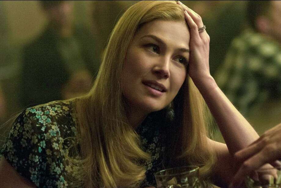 """In this image released by 20th Century Fox, Rosamund Pike appears in a scene from """"Gone Girl."""" The film, based on the best-selling novel, will release on Oct. 3. (AP Photo/20th Century Fox, Merrick Morton) Photo: Merrick Morton / Associated Press / 20th Century Fox"""
