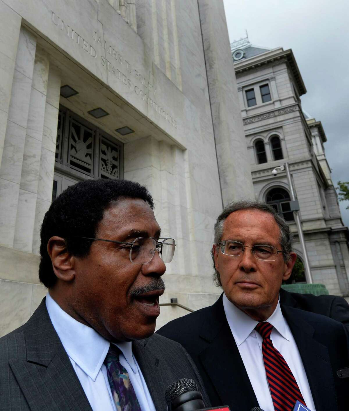 Assemblyman William Scarborough speaks to the media under the supervision of his attorney E. Stewart Jones, right, after his appearance in Federal Court Wednesday afternoon Oct. 1, 2014 in Albany, N.Y. (Skip Dickstein/Times Union)