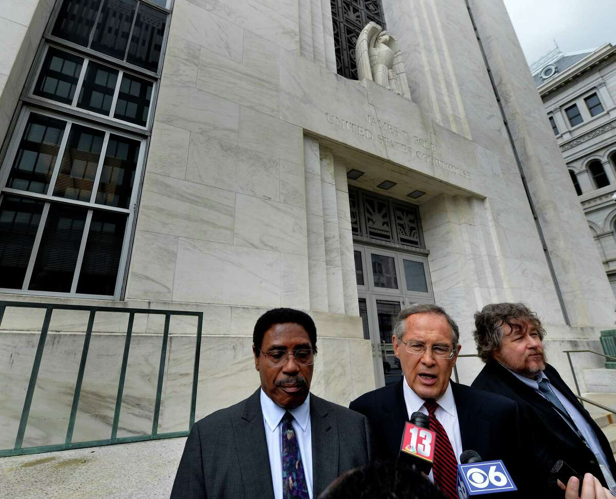 Assemblyman William Scarborough, left, listens as his attorney E. Stewart Jones, center, speaks after his appearance in Federal Court Wednesday afternoon Oct. 1, 2014 in Albany, N.Y. (Skip Dickstein/Times Union)